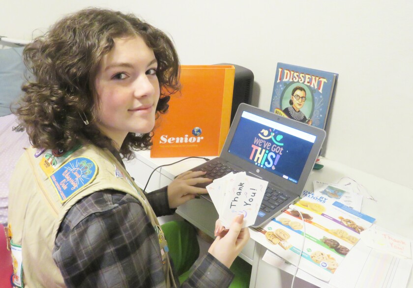 Senior Girl Scout Maddy Powers working on her Digital Cookie website.