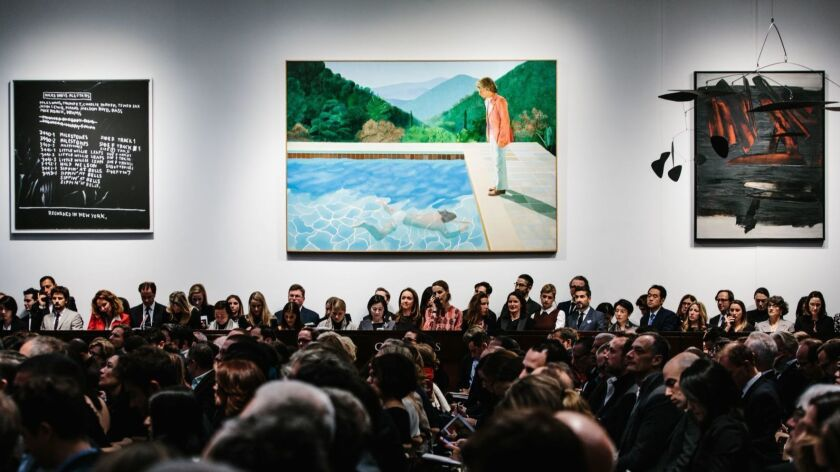 """David Hockney's """"Portrait of an Artist (Pool with Two Figures)"""" is displayed at Christie's auction house in New York on Nov. 15."""