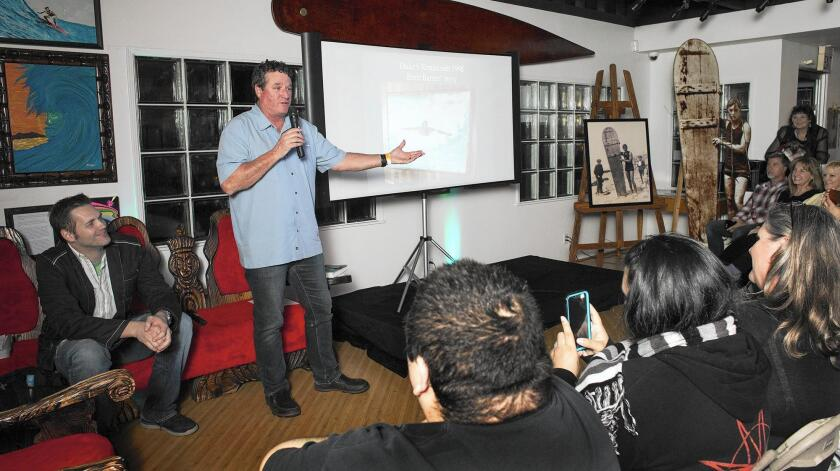 """Brett Barnes, owner of Duke's restaurant in Huntington Beach, shares a story about a bodyboarder riding a wave in 1998 — whom Barnes believes to be the ghost of legendary surfer Duke Kahanamoku — during """"Night at the Surfing Museum"""" at the International Surfing Museum in Huntington Beach."""