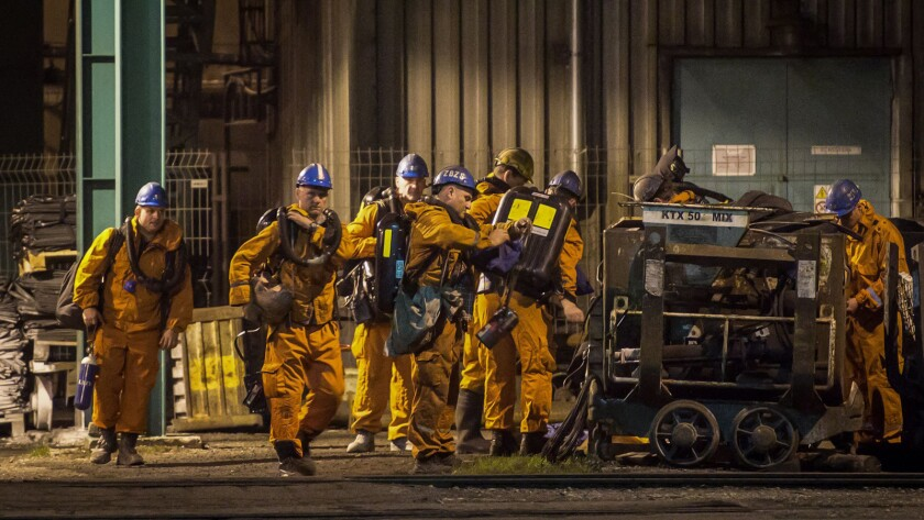 Rescue workers prepare their equipment at the CSM coal mine near in Karvina, Czech Republic, on Dec. 20.