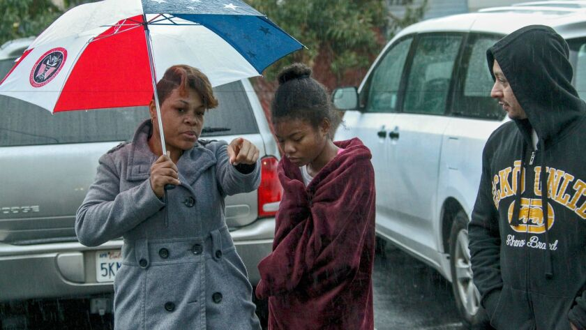 Claressa Dupree, left, with her 16-year-old daughter Selah Washington, recalls the shootout between Pomona police officers and a man who lived across from her apartment in Pomona. The man was killed, officials said.