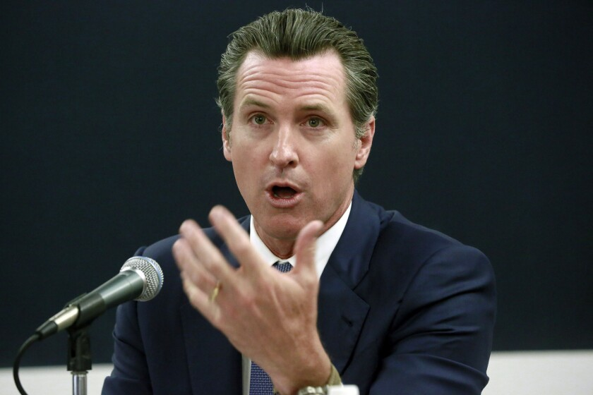 Lt. Gov. Gavin Newsom chairs the State Lands Commission, which has sued to nullify a San Francisco ballot measure limiting waterfront development.