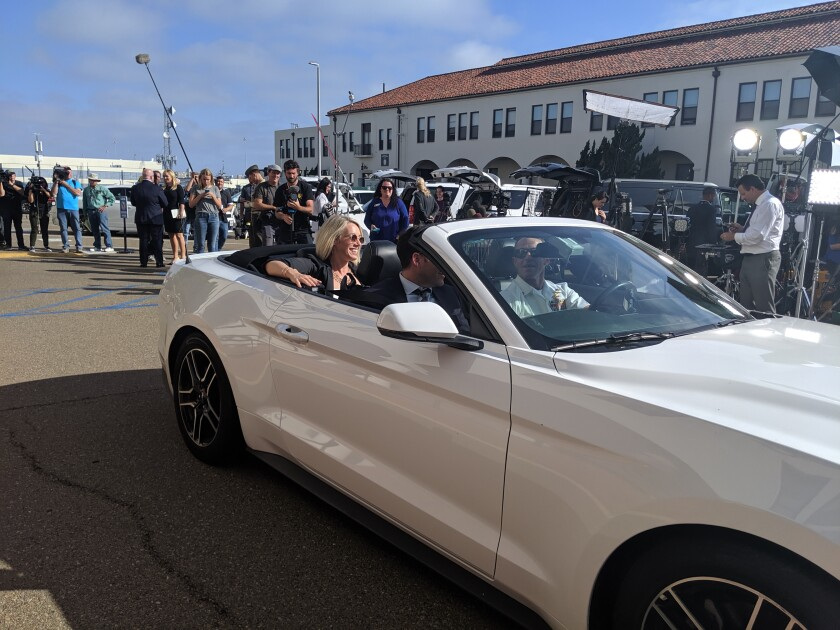 Andrea Gallagher, rear seat, and her brother-in-law Sean Gallagher, are all smiles leaving a Navy courthouse in a Ford Mustang convertible driven by Navy SEAL Chief Eddie Gallagher the day he was found not guilty of murder by a military jury, July 2, 2019.