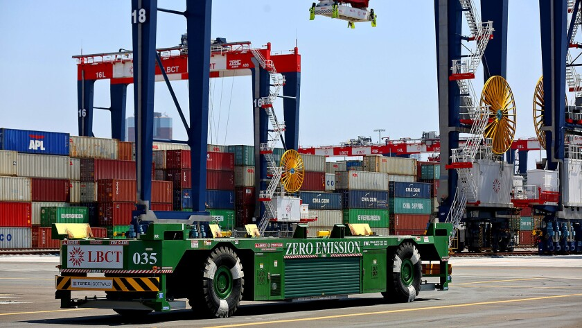 A driverless, electric-powered vehicle is seen at the Port of Long Beach. Maersk and APM Terminals say proposed battery-powered vehicles would replace diesel rigs as a response to the Port of L.A.'s clean-air rules.