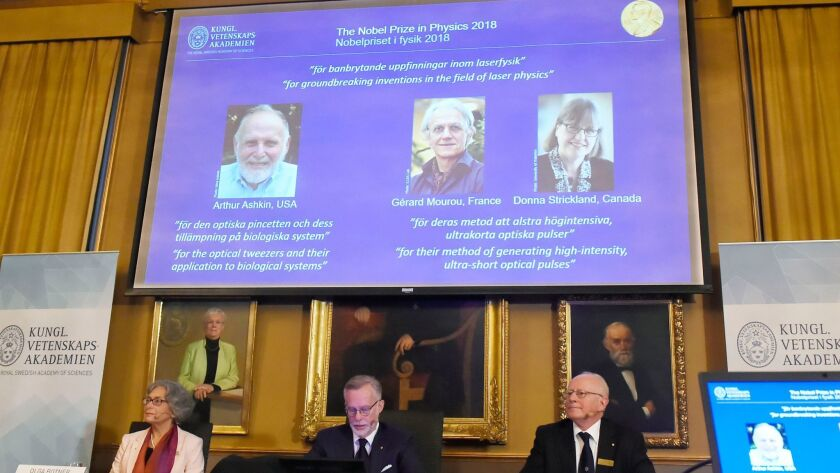 Members of the Nobel committee announced that Arthur Ashkin of the U.S., Gerard Mourou of France and Donna Strickland of Canada won the physics prize for their pioneering work on lasers.