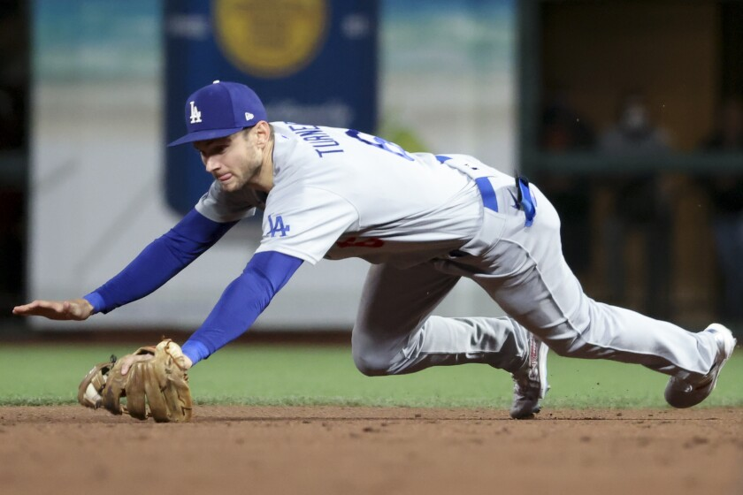 San Francisco, CA - October 09: Los Angeles Dodgers second baseman Trea Turner dives for a ground ball hit by San Francisco Giants' Wilmer Flores during the sixth inning of game two in the 2021 National League Division Series at Oracle Park on Saturday, Oct. 9, 2021 in San Francisco, CA. (Robert Gauthier / Los Angeles Times)
