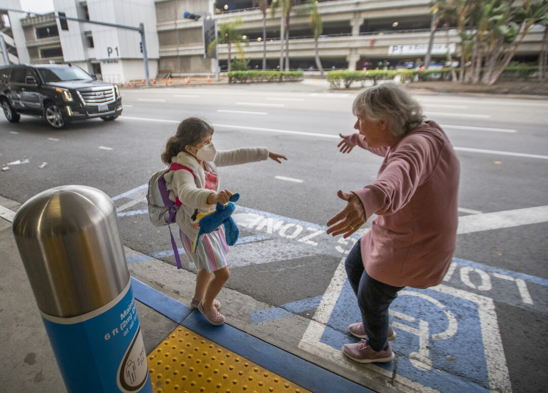 Jacquie Carney, 7, of San Antonio runs to hug her grandmother, Donna Vidrine of San Clemente at LAX.