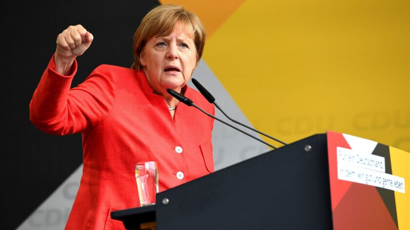 German Chancellor Angela Merkel delivers a speech during an election campaign event of the Christian Democratic Union party in Cuxhaven, western Germany, on August 15, 2017.