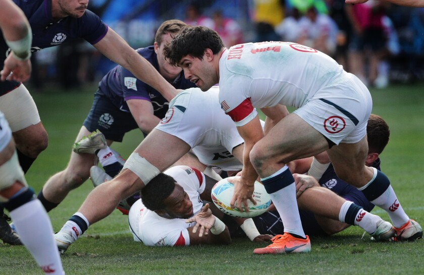USA 7s Carlin Isles passes the ball to Madison Hughes (10) out of the scrum against Scotland 7s during a match Feb. 29, 2020, at the HSBC World Rugby Sevens tournament in Carson.