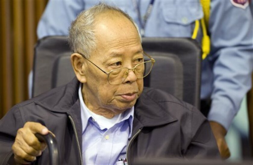 FILE - In this Nov. 23, 2011 file photo released by the Extraordinary Chambers in the Courts of Cambodia, former Khmer Rouge Foreign Minister Ieng Sary sits during the third day of a trial of the U.N.-backed war crimes tribunal in Phnom Penh, Cambodia.  Ieng Sary, who co-founded Cambodia's brutal K