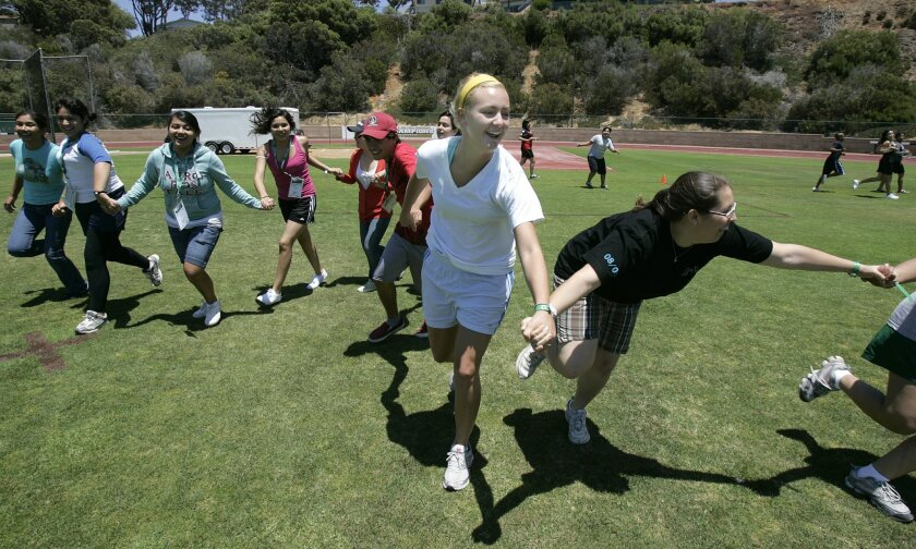 <p>  Nikki Lynn (center), a sophomore at Point Loma Nazarene University, led students from the Sweetwater high school district in a team-building exercise at a college-preparatory camp. The junior-year-bound students are halfway through a four-year program called GEAR UP.  <em>   &#820