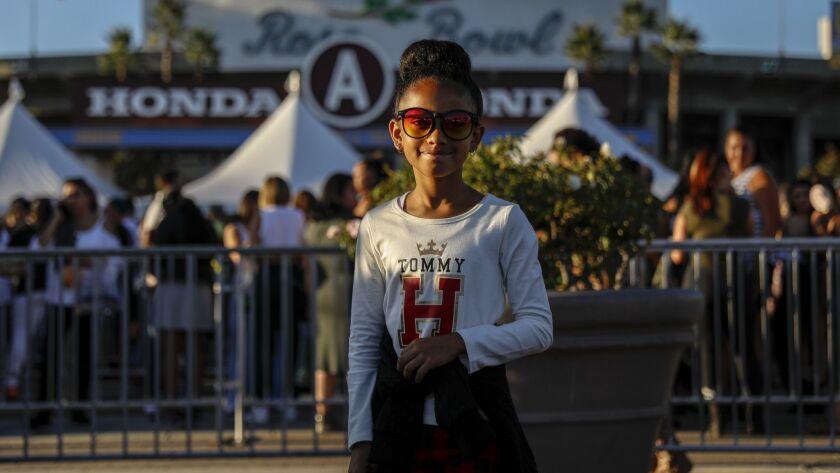 PASADENA, CA --SEPTEMBER 22, 2018 --Mireya Sade,8, from Los Angeles, stops for a photo while enteri