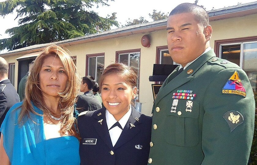 Maria Cordova (left) stands with daughter Jennifer Moreno (center) at Moreno's commissioning ceremony to become an Army officer.