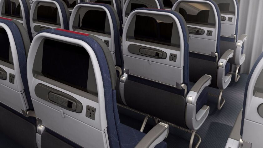 The seats on American Airlines 777-300ER have seat-back entertainment systems. American plans to ditch the systems on its 737-MAX planes and let passengers use their own devices for entertainment.
