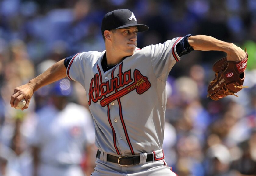 Atlanta Braves starter Matt Wisler delivers a pitch during the first inning of a baseball game against the Chicago Cubs, Sunday, Aug 23, 2015 in Chicago. (AP Photo/Paul Beaty)
