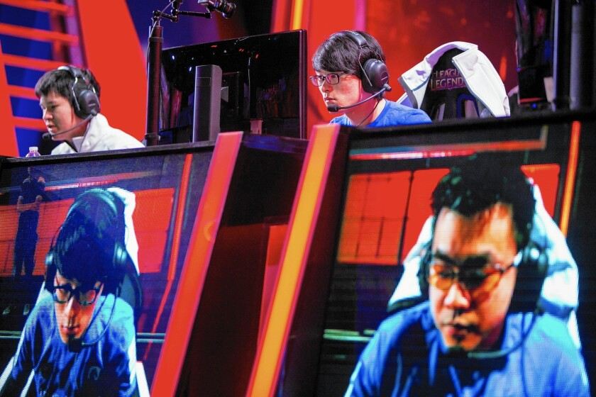 Tencent Holdings Ltd., a Chinese firm, bought a majority stake in video-game maker Riot Games in 2011 for $250 million. Above, a video game competition at Riot's L.A. studio.