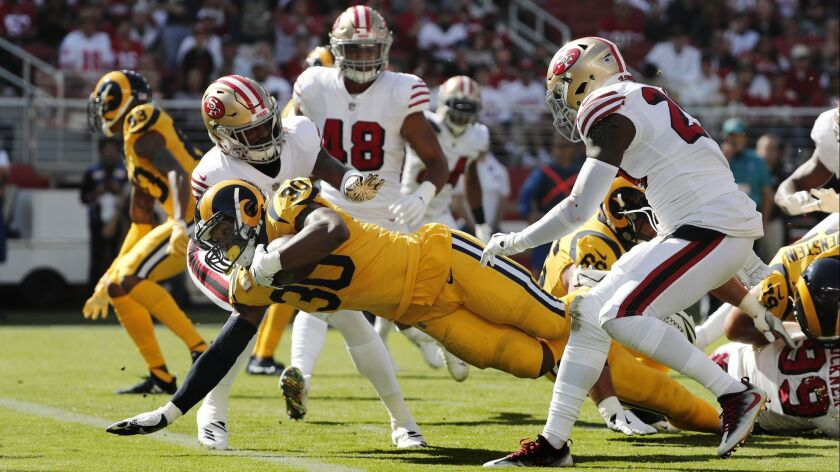 Rams running back Todd Gurley (30) scores on a 7-yard run against the San Francisco 49ers.
