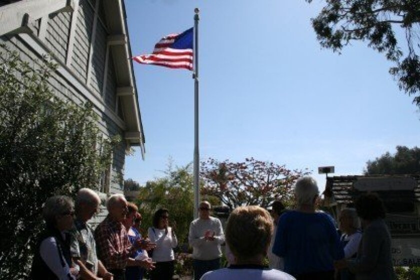The Feb. 21 flagpole ceremony at the Del Mar Library.