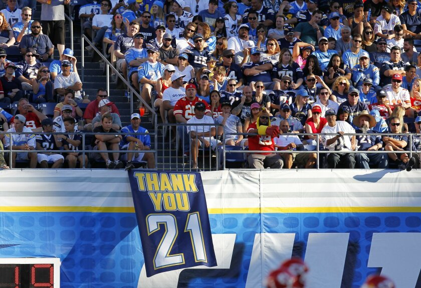 Fans thank LaDainian Tomlinson, who had his number 21 retired at halftime of the Chiefs game.
