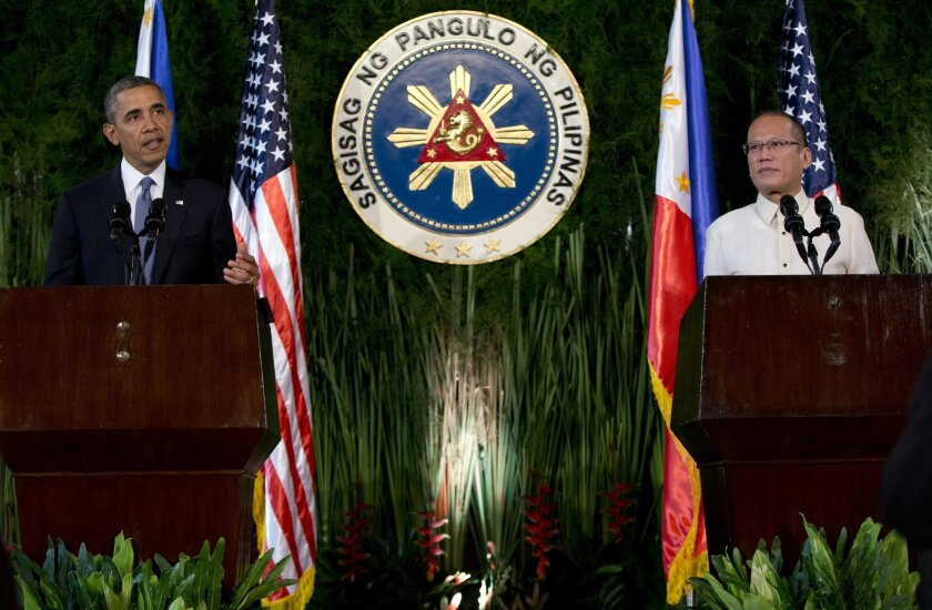 U.S. President Barack Obama, left, speaks as Philippine President Benigno Aquino III looks on during a joint news conference at Malacanang Palace in Manila, the Philippines, Monday, April 28, 2014. Obama is assuring Filipinos that a new security agreement doesn't mean the U.S. is trying to reestablish military bases in their country. Obama says a deal signed Monday to give the U.S. military greater access to Philippine bases will help strengthen security in the region. He said it also will allow for a faster response to natural disasters. (AP Photo/Carolyn Kaster)