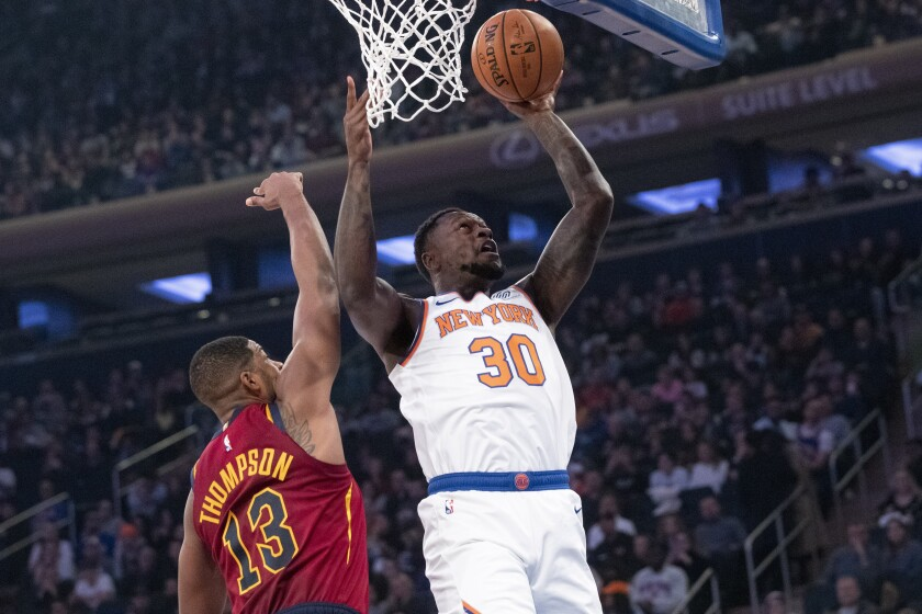 New York Knicks forward Julius Randle (30) goes to the basket past Cleveland Cavaliers center Tristan Thompson (13) during the first half of an NBA basketball game, Sunday, Nov. 10, 2019, at Madison Square Garden in New York. (AP Photo/Mary Altaffer)