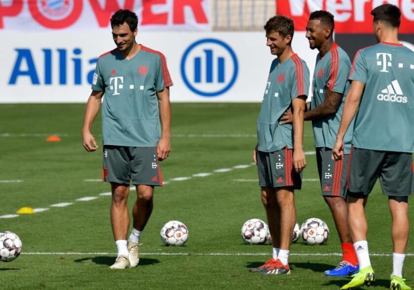 Fotografía de archivo que muestra a los jugadores del Bayern Munich (i-d) Mats Hummels, Mats Hummels (i), Thomas Müller (c) y Jerome Boateng. EFE/Archivo