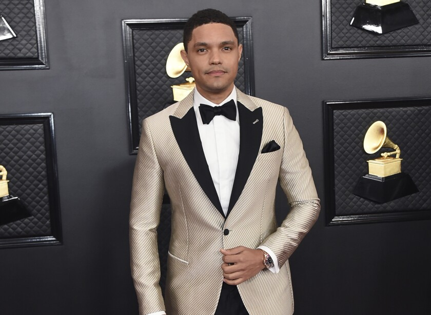 FILE - Trevor Noah arrives at the 62nd annual Grammy Awards in Los Angeles on Jan. 26, 2020.