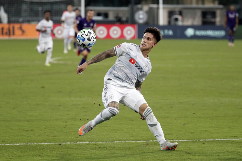 LAFC's Brian Rodriguez moves to control the ball against Orlando City.