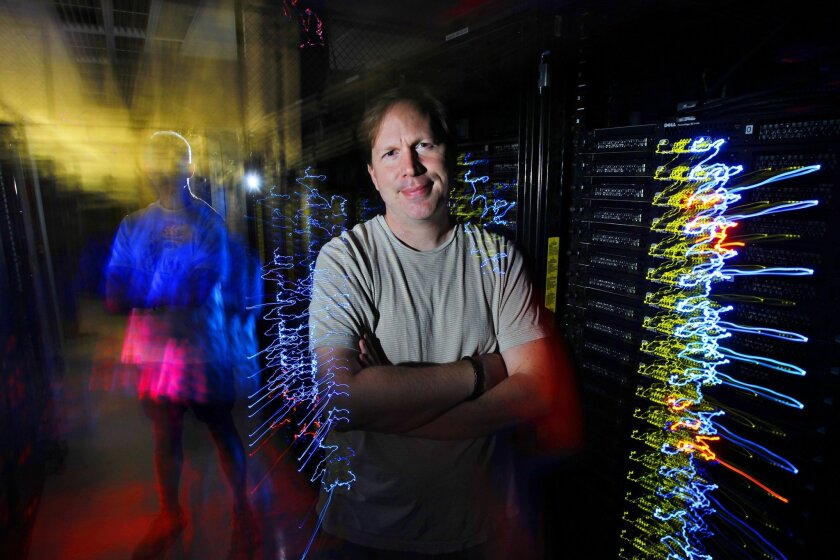 UCSD professor Stefan Savage, who is an expert at revealing how cyber crooks electronically break into businesses, stands in a server room at UCSD on Friday in San Diego, California.
