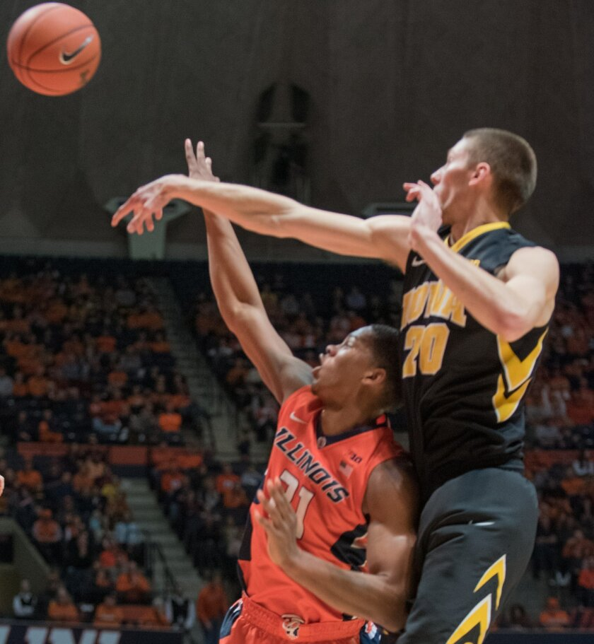 Iowa forward Jarrod Uthoff (20) rejects a shot by Illinois' Malcolm Hill(21) during an NCAA college basketball game in Champaign, Ill., Sunday, Feb. 7, 2016. (AP Photo/Robin Scholz)