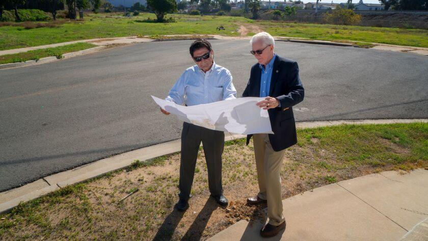 Jean Diaz, Executive Director for the San Diego Community Land Trust (left) and Tom Scott, Board Mem