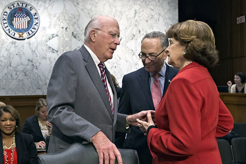 Senate Judiciary Committee Chairman Patrick Leahy (D-Vt.) left, confers with Sens. Chuck Schumer (D-N.Y.) and Dianne Feinstein (D-Calif.) on Monday.