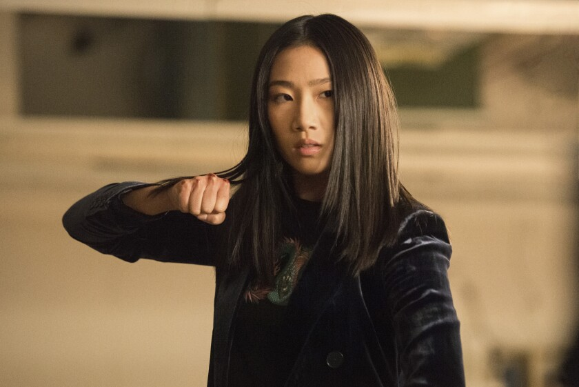 "Olivia Liang holds up her clenched fist in ""Kung Fu"" on the CW"