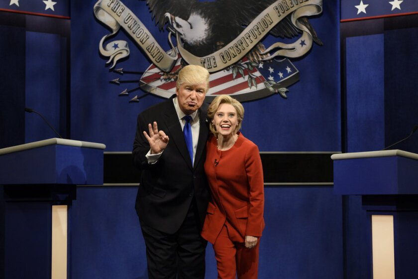 Alec Baldwin as Donald Trump and Kate McKinnon as Hillary Clinton in the opening sketch of NBC's 'Saturday Night Live' premiere.