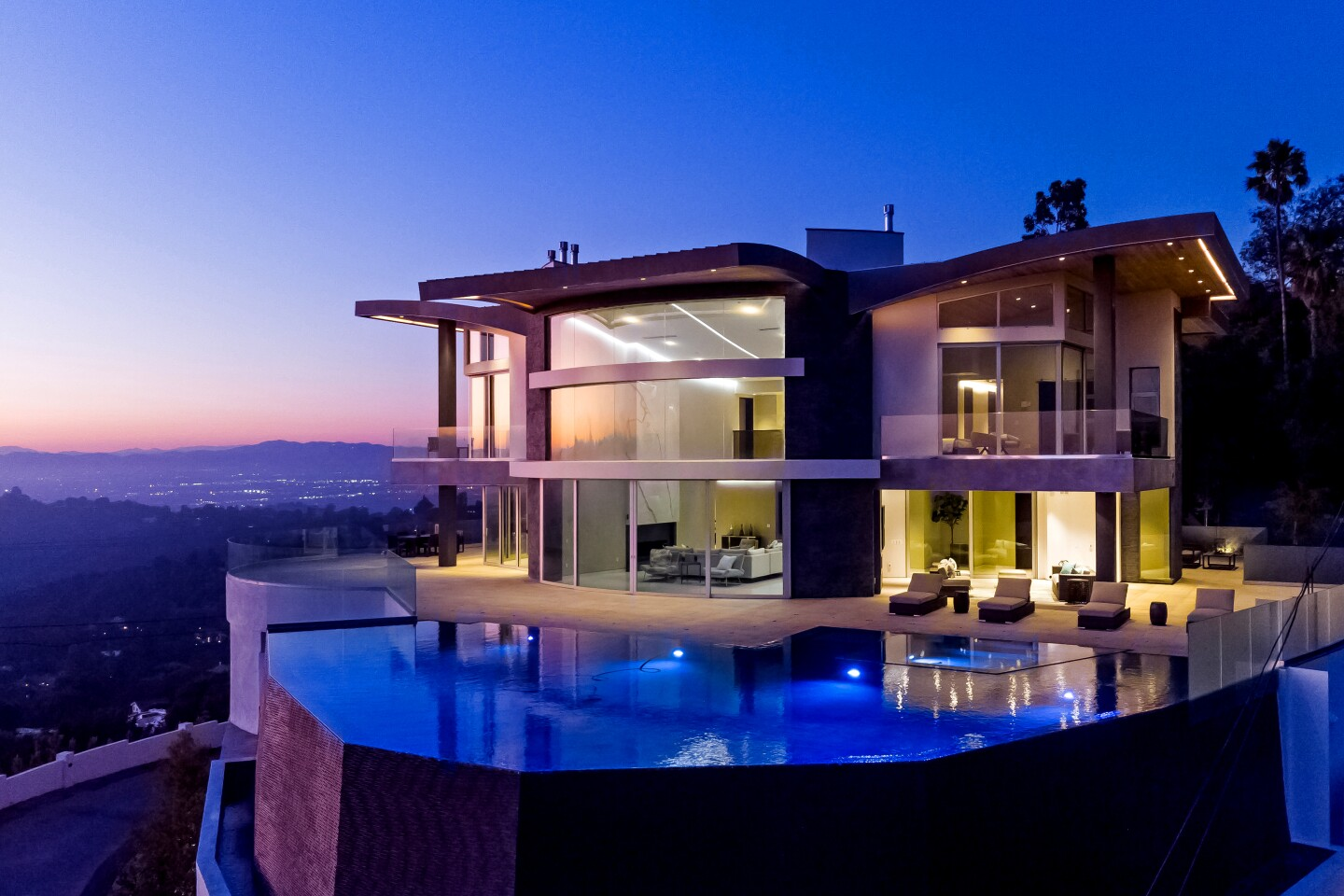 The modern Beverly Crest mansion, designed by architect Jay Vanos, sold to a limited liability company tied to Top Dawg Entertainment founder Anthony Tiffith. Eye-catching from top to bottom, the 13,100-square-foot showplace on Bowmont Drive features white marble slabs, a golf simulator and spa facilities that include a Turkish bath. (Marc Angeles / Unlimited Style Real Estate Photography)