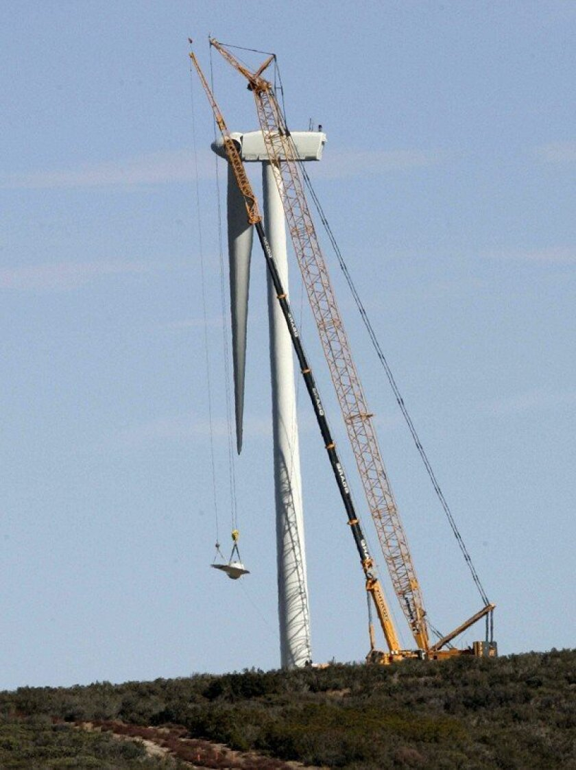 Cranes were used to lower the blades of the turbines. Repairing the wind farm is expected to take a month or two.