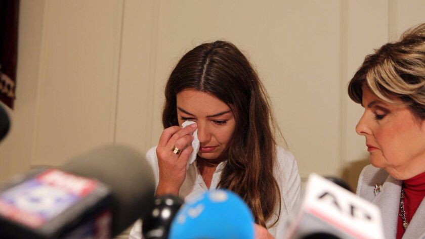 Mimi Haleyi cries at a press conference as she describes the alleged sexual abuse she claims she su