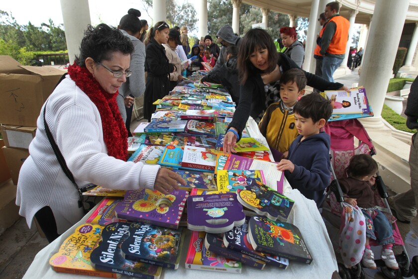 Roosevelt Brown's 30th annual Children's Book Party went off smoothly even though it was threatened by rain.  Brown had the tables and books moved up under the Organ Pavillion's promenade in case the rain that hit the area over night started again in the