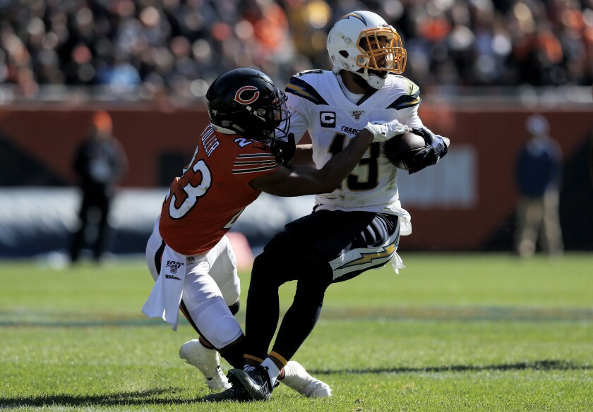 Chargers wide receiver Keenan Allen runs with the ball while being tackled by Chicago Bears cornerback Kyle Fuller during the second quarter of Sunday's 17-16 win.