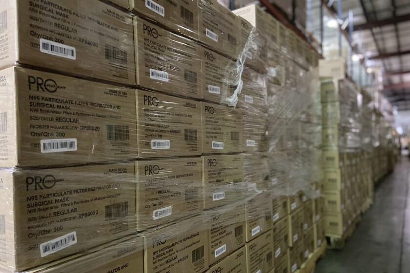 This Friday, Feb. 5, 2021 photo provided by Prestige Ameritech shows boxes of the company's N95 masks in warehouse storage at North Richland Hills, Texas, outside of Fort Worth. One year into the COVID-19 pandemic, the U.S. finds itself with many millions of N95 masks pouring out of American factories and heading into storage. Yet there still aren't nearly enough in ICU rooms and hospitals.(Chris Tarrant/Prestige Ameritech via AP)