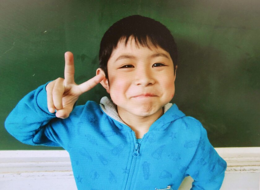 This undated photo released Friday, June 3, 2016, by Hamawake Elementary School shows 7-year-old Yamato Tanooka, who was found safe nearly a week after he was abandoned in the forest by his parents in Nanae, Hokkaido, northern Japan. The boy's safe return was welcomed in a nation riveted by his dis