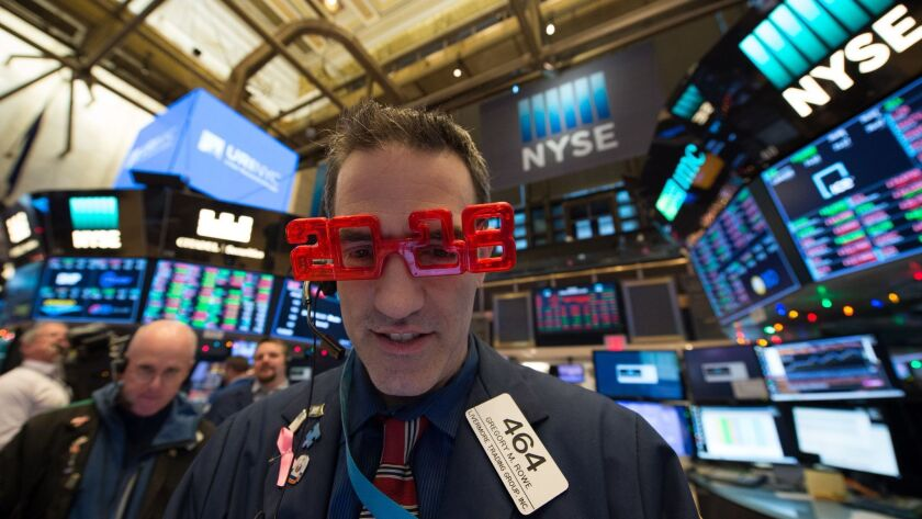 """A trader wears """"2018"""" glasses at the New York Stock Exchange on Friday."""