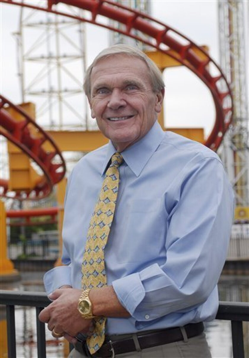 FILE - In this May 7, 2008 file photo, Cedar Fair Entertainment Co. chief executive Richard Kinzel poses for a picture at Cedar Point Amusement Park in Sandusky, Ohio. Kinzel is on a bumpy ride as he tries to maintain control of the company. A hedge fund that holds the most shares of North America's third-largest chain, wants Kinzel ousted as board chairman. The fight has been playing out in full-page newspaper ads in recent weeks, and now shareholders will decide Tuesday, Jan. 11, 2011, whether to block company officeholders from serving as chairman. (AP Photo/Frank Wiewandt, File)