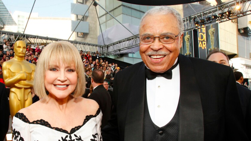 Cecilia Hart with her husband, James Earl Jones, at the Oscars in 2012.