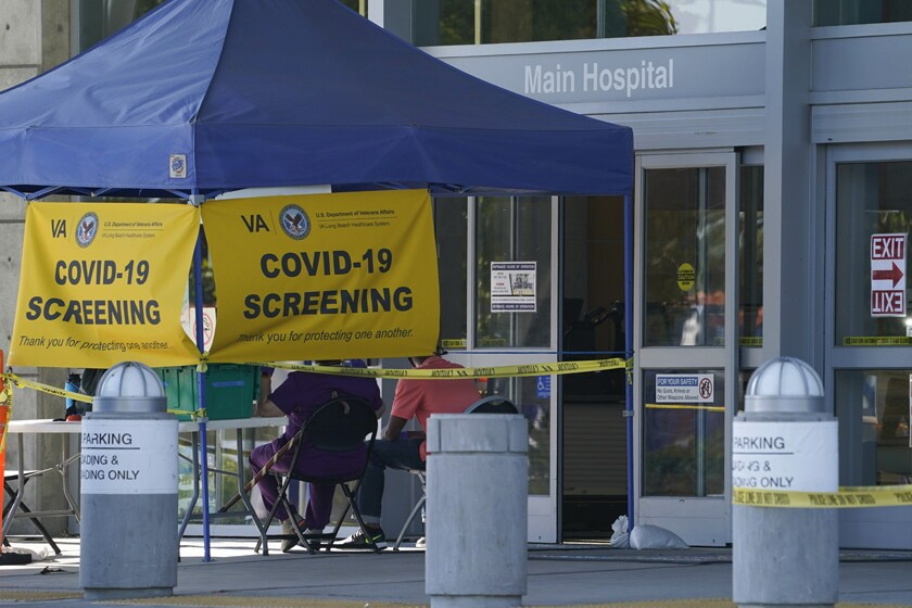 This file photo shows a COVID-19 screening site outside the VA Long Beach Healthcare System.