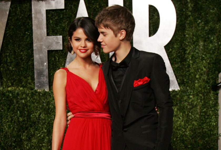 Selena Gomez and Justin Bieber step out together at the 2011 Vanity Fair Oscars party.