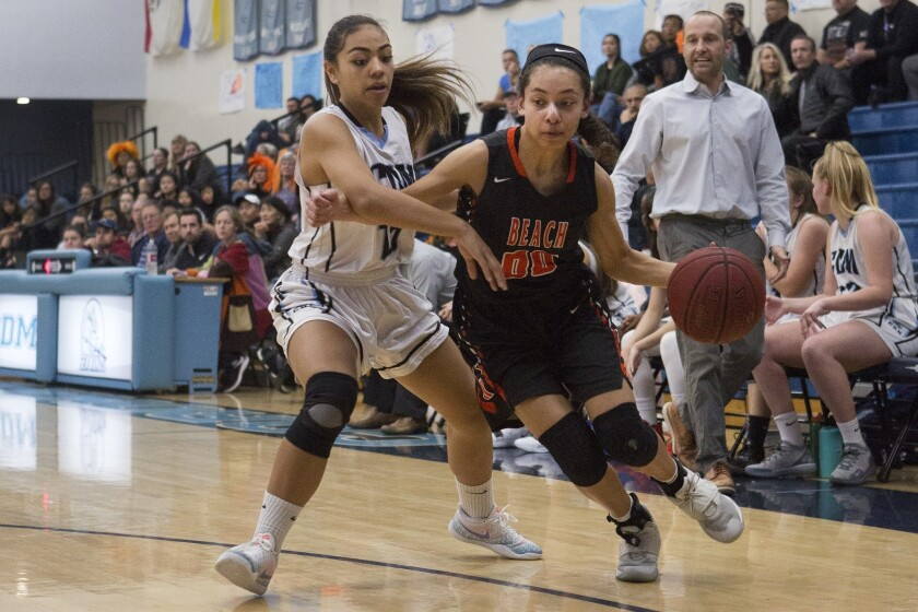 Huntington Beach's Meghan McIntyre pushes past Corona del Mar's defense during a Surf League game on