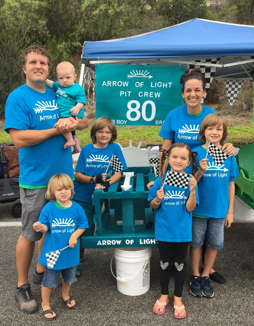 The Wright Family of Fallbrook, served as pit crew for their sons, Brogan, 9, next to Dad and Brigston, 7, in front of Mom, at last year's Orange Crate Derby. Although they didn't win, the boys will return this year in their respective cars, 80 Arrow of Light (Brogan) and 42 Big Barracuda (Brigston) not shown.