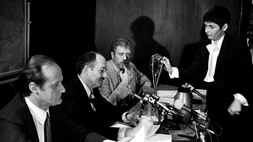 DEC. 16, 1981 -- Attorney Gloria Allred presents a chastity belt to former State Sen. John G. Schmit