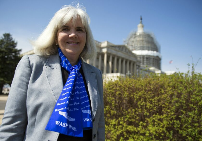 FILE - In this March 16, 2016, file photo, Terry Harmon, daughter of WWII veteran WASP (Women Airforce Service Pilots), Elaine Harmon, speaks to reporters after an event with members of congress on the reinstatement of WWII female pilots at Arlington National Cemetery on Capitol Hill in Washington.